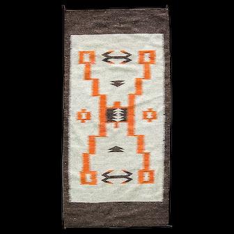 "28' x 58"" Storm Pattern Navajo Rug, circa 1930"