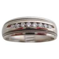 Gentlemens 14kt vintage white gold and diamond wedding band.