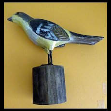 Hand Carved Bird perched on a log stand