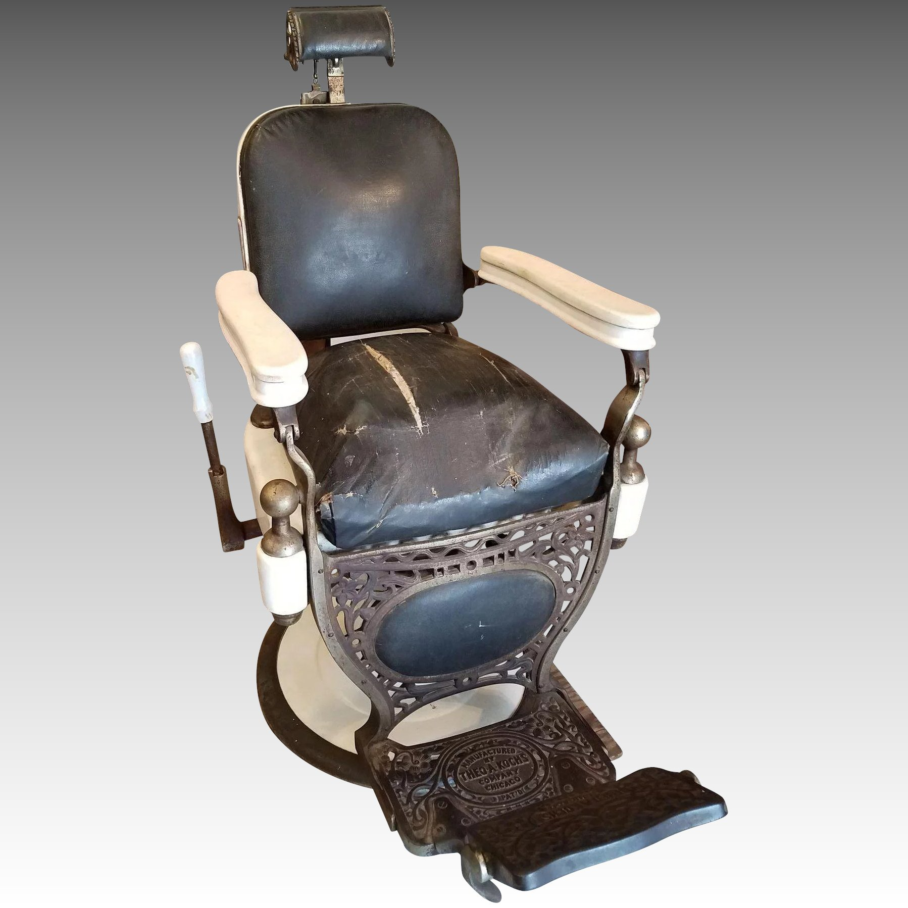 Theo A Kochs Barber Chair With Childs Seat. Click To Expand