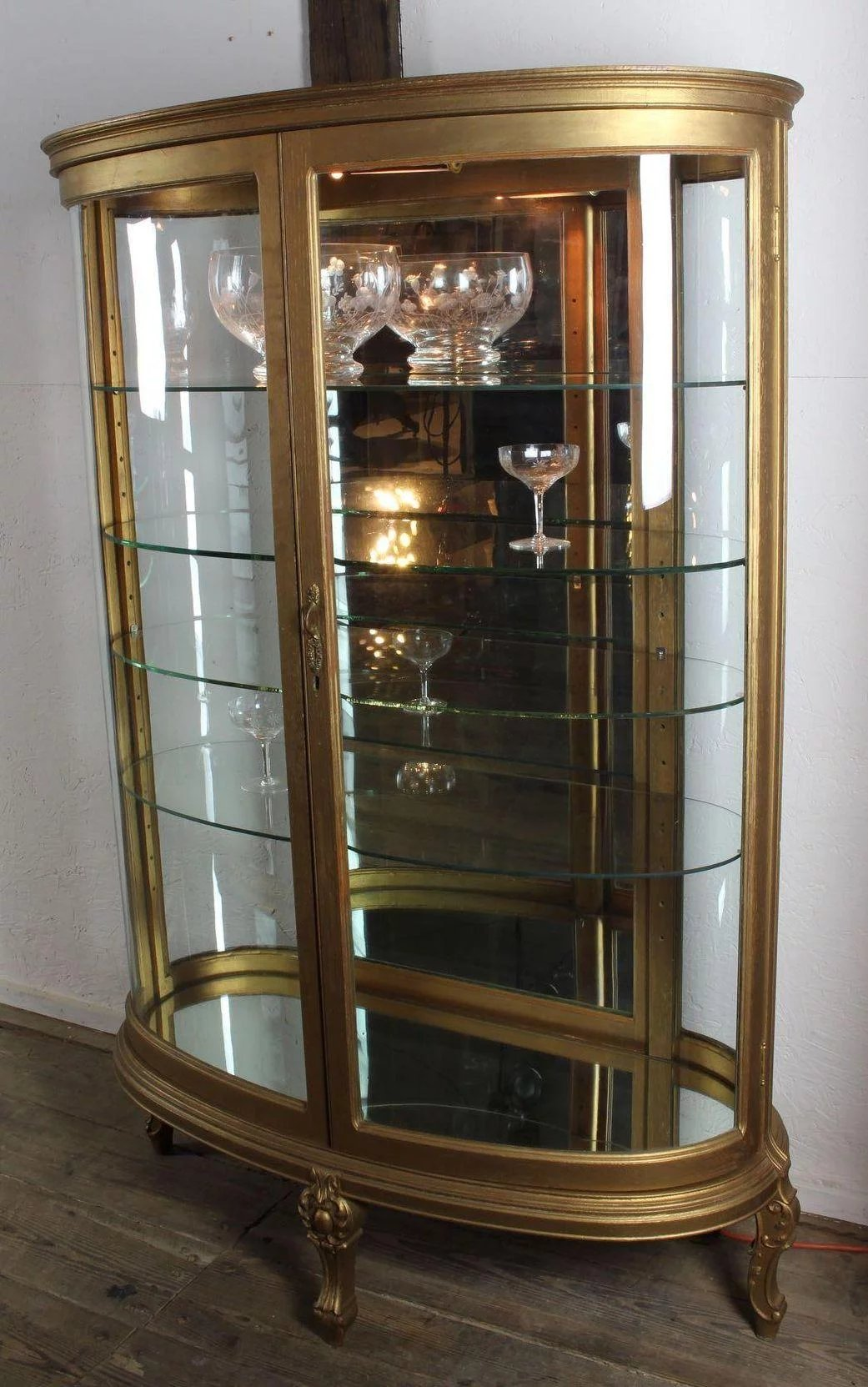 Oval Curved Glass Curio Cabinet C. 1900. Click To Expand