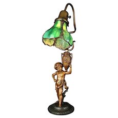 Bradley & Hubbard Boy w Vase Stained Glass Table Lamp     c. 1920