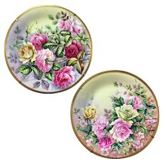 Pair of hand-painted rose Limoges France chargers with white enamel, 1950s