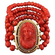 Wow 59.7g! Rare 18kt gold four strand faceted red coral bead bracelet with a cameo of Bacchante in full face, 1850s French work.