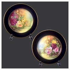 Pair of Limoges France porcelain hand-painted roses cobalt blue chargers, artist signed, 1930