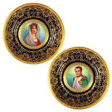 "Ornate pair of 11'' Limoges France painted portrait cobalt blue chargers/ plats, ""Napoleon I and Queen Josephine"", heavy raised gold gilt, artist signed ""E. Furlaud"", 1900-1932"