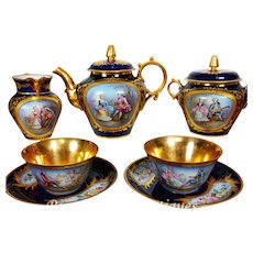 "1876~~Museum quality~~SEVRES France porcelain hand-painted ""tête à tête"" Tea/ coffee Set of 7 pieces, cobalt blue & gold, hand-painted courting couple scenes and floral motif, with Sèvres marks, artist signed "" J. Aublet"", 1876-1878"