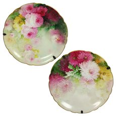 "11.6"" Pair of hand painted Limoges France chargers with the roses and mums; artist signed ""Bio"", ca 1890 to 1932"
