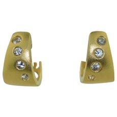 14K White Topaz Huggie Earrings