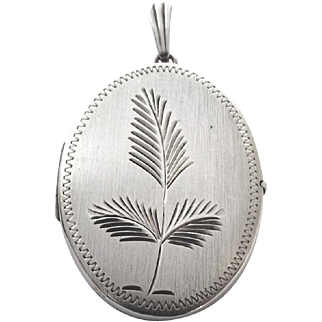 Vintage sterling silver oval locket with fern decoration