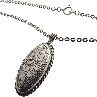 Unusual vintage sterling silver locket and chain