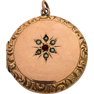 Antique rose gold locket with garnet and seed pearls