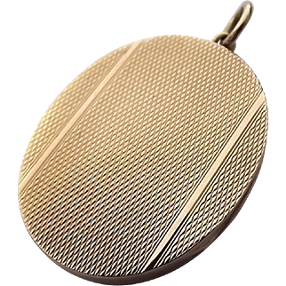 Vintage 9ct gold hallmarked oval locket with deco design
