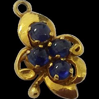 Antique 18k gold cabochon sapphire charm