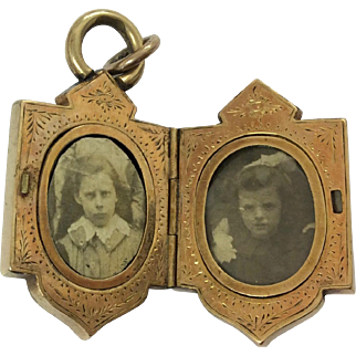 Antique gold locket with pretty decoration to the interior