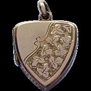 Petit antique 9ct gold locket with ivy leaf decoration