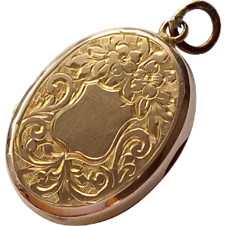 Small but dainty antique 9ct rose gold back and front locket