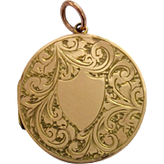 Pretty antique 9ct back and front round locket with lovely decoration