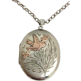 Vintage silver & rose gold love bird locket and 20 inch silver chain