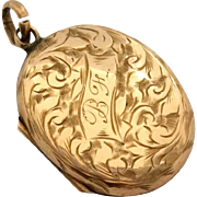 Small but dainty antique 9ct rose gold locket with fancy decoration