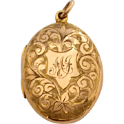 Pretty antique 9ct rose gold locket with fancy flower decoration