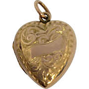 Pretty antique 9ct rose gold puffy love heart locket