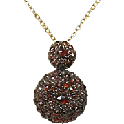 Antique Victorian Sterling Silver Garnet Pendant with a gold filled chain