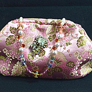 Vintage pink brocade evening bag with a Miriam Haskell pin as the clasp and crystal studded chain