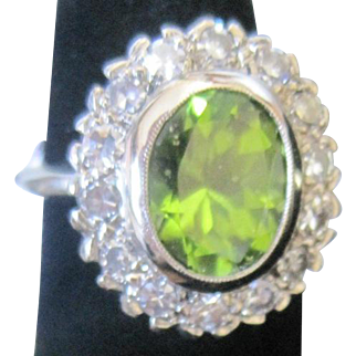 Vintage 14k white gold ring set with a large oval peridot surrounded with diamonds