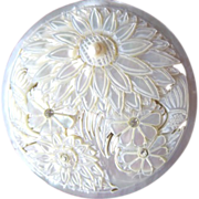 New old stock Mother of Pearl carved compact in bag from Peacock Jewelers Chicago