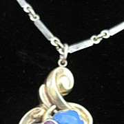 Victorian 18k yellow gold blue enamel flower pendant bezel set with pink garnets on a gold filled chain