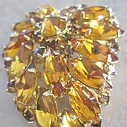 All amber colored rhinestones in a  leaf shape pin