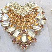 Vintage yellow and amber rhinestone parure consisting of necklace, pin and clip earrings