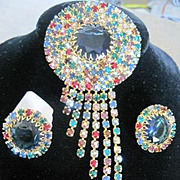Multi colored waterfall pin and clip earrings made with all prong set multi colored rhinestones
