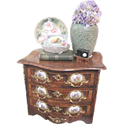 Small Vintage fruit wood three drawer cabinet with gold washed ormolu garnishes and painted scenic decoration