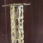 Brass highly decorated cupid & flower candlestick