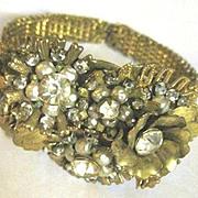 Vintage Multi beaded bracelet decorated with flowers imitation pearls gold leaves and rhinestones