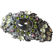 Flexible cuff rhinestone bracelet made by Hollycraft in warm winter tones of olivine, yellow and pinks