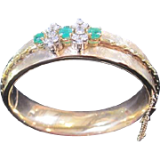 Ladies vintage diamond and emerald bangle bracelet with appraisal