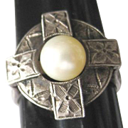 Hallmarked Celtic sterling 950 ring set with cultured pearl center. Heavily etched and architectural in style.