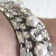 Dress up your wrist with this rhodium plated rhinestone encrusted bracelet with faux pearl accents