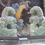 Late Qing Dynasty pair of carved semi precious Jade Foo Dogs on wood stands meant to guard against negative energy