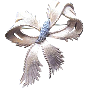 Vintage Florenza florentine bow pin accented by rhinestones