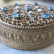 Vintage French bronze heavily decorated powder compact with jewels on top puff and mirror inside