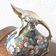Vintage Porcelain Austrian Carlsbad pitcher featuring applied and hand painted flowers