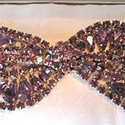 Glamorous purple rhinestone bracelet with a bow tie theme