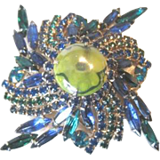 Sizzling green and blue swirl all Rhinestone PIN with a molded glass DRAGON EYE center