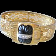 Edwardian gold gilt filagree cuff bracelet with black glass center set with a line of rhinestones