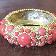 Vintage Graziano bangle bracelet with orange accents in gold washed metal