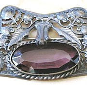 Exceptional Victorian pewter sash pin surrounding a large purple glass jewel embellished with vines